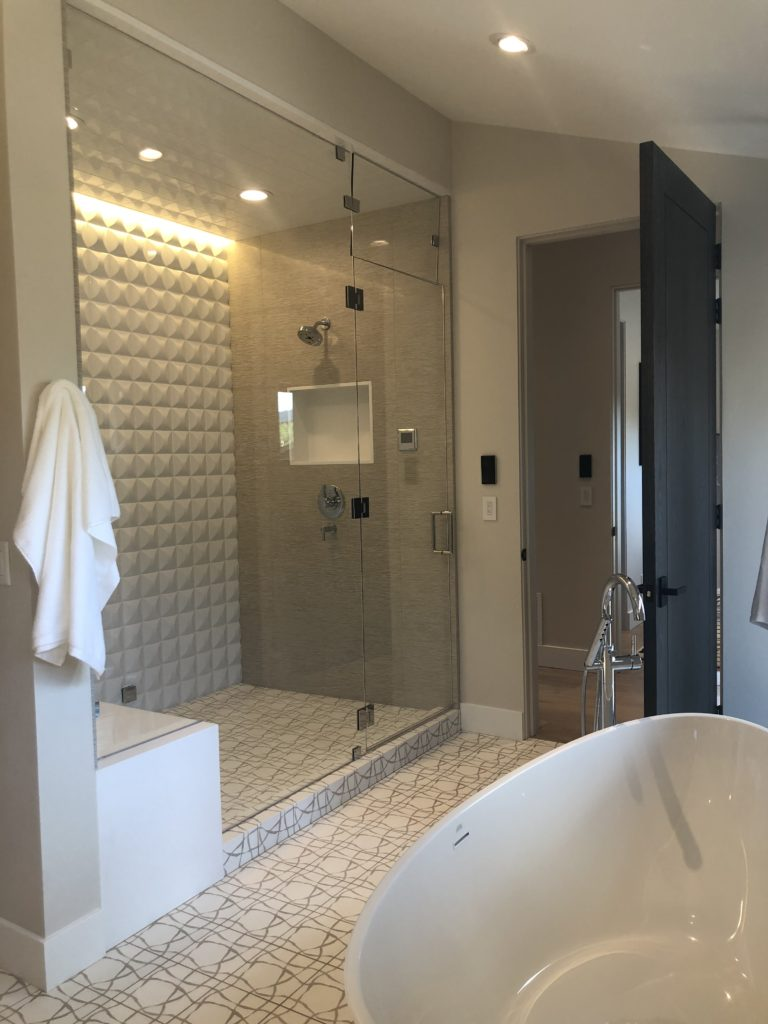 framless inline steam shower with transom