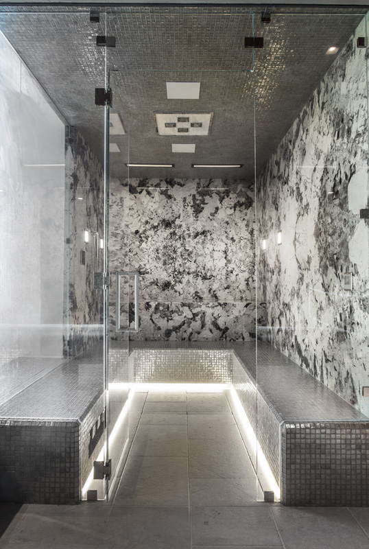 steam room with framless shower glass