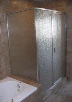 framed shower with rain glass